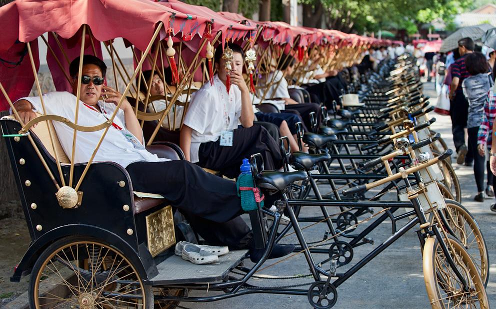 Пекинские рикши