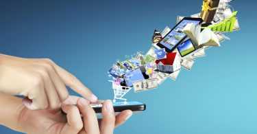 Touch screen mobile phone in hand with businessmen