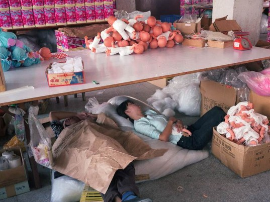 Chinese people sleep under their working tables