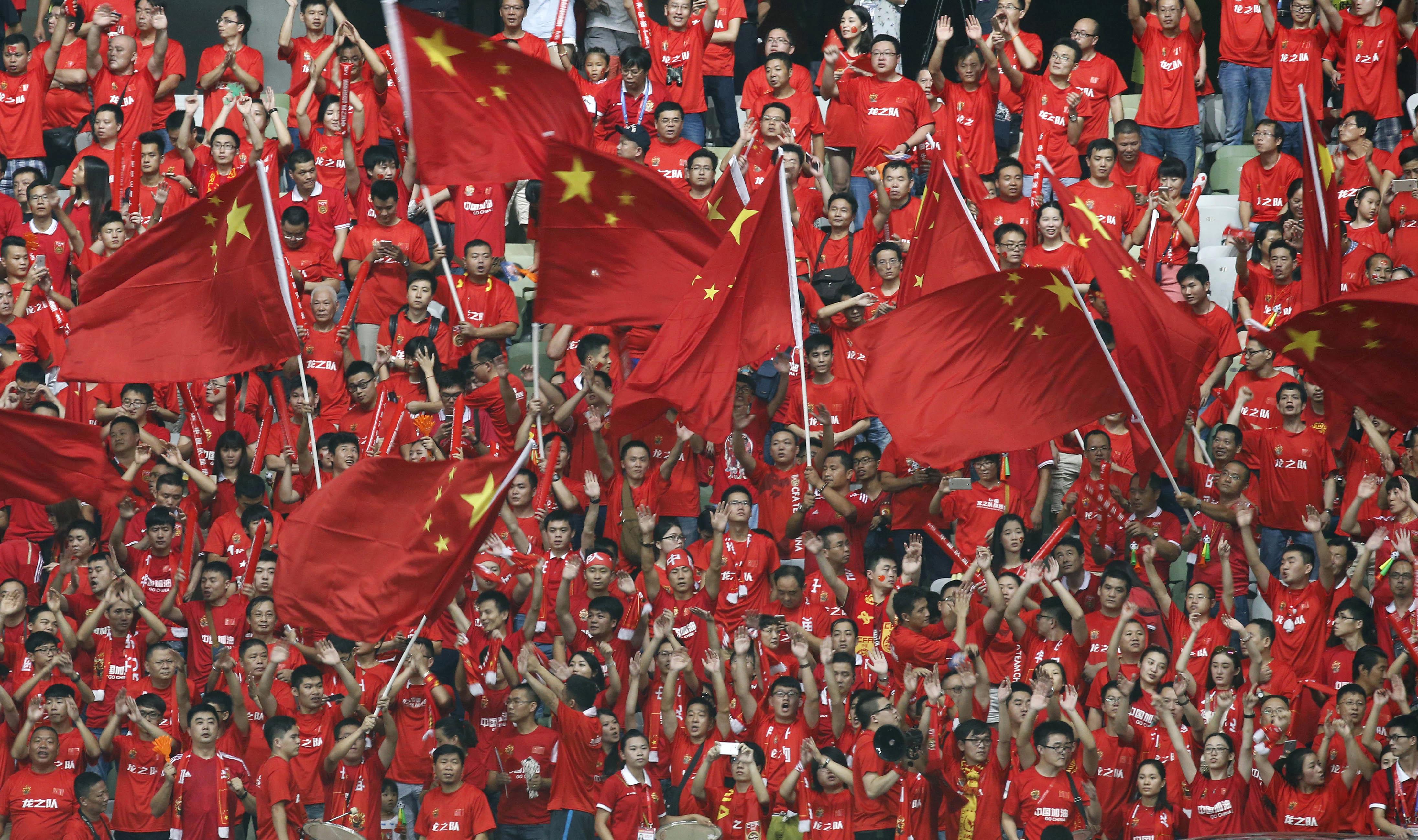 Болельщики китайской футбольной сборной. Фото: AP