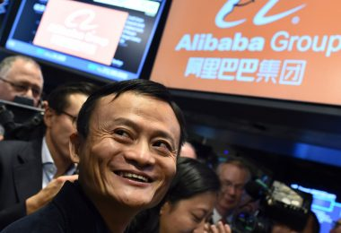 Chinese online retail giant Alibaba founder Jack Ma smiles as he waits for the trading to open on the floor at the New York Stock Exchange in New York on September 19, 2014. A buying frenzy sent Alibaba shares sharply higher Friday as the Chinese online giant made its historic Wall Street trading debut. In early trades after the record public share offering, Alibaba leapt from an opening price of $68 to nearly $100 and, while it dropped back, was still up some 38 percent at $94.08 after 10 minutes. AFP PHOTO/Jewel Samad